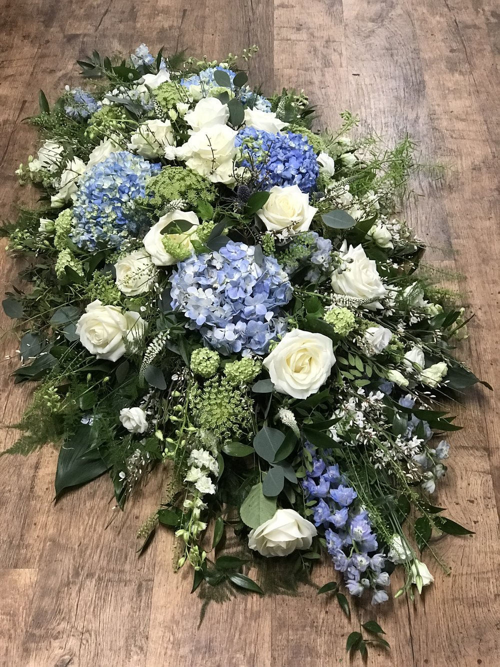 Country Garden Coffin Spray in ivory and blue