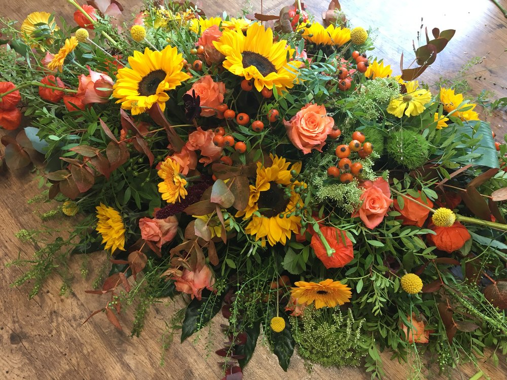 Summer Coffin Spray with Sunflowers and orange Roses