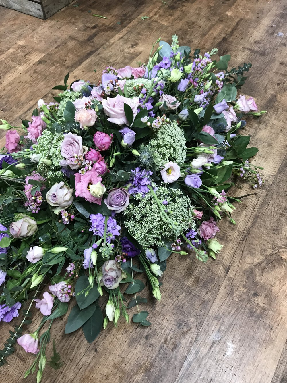 Luxury Country Garden Coffin Spray in pink and lilac