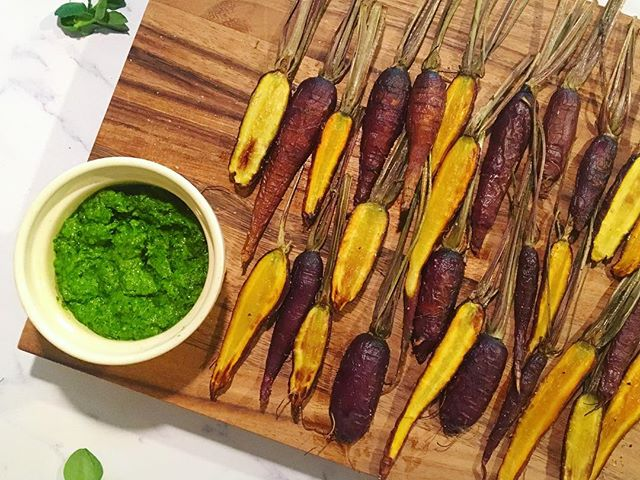 Combining some of my favorite farm nosh into a quick snack that screams of FRESH flavor... uniquely sweet Pea Shoot Pesto and roasted Purple Dragon Carrots!  Also, does it make me crazy if I've never owned an ironing board but consider a cutting board a solid investment? 🤷‍♀️ This one from @ironwood_acacia_wood is my new bff 💕 Happy FrIDaY!! . . . . . #eatyourgreens #asseenincolumbus #supportsmallfarms #eatlocalgrown #knowyourfarmer #acaciawood #eattherainbow #healthyfoodshare #healthysnacks #wholefoods #tastespotting