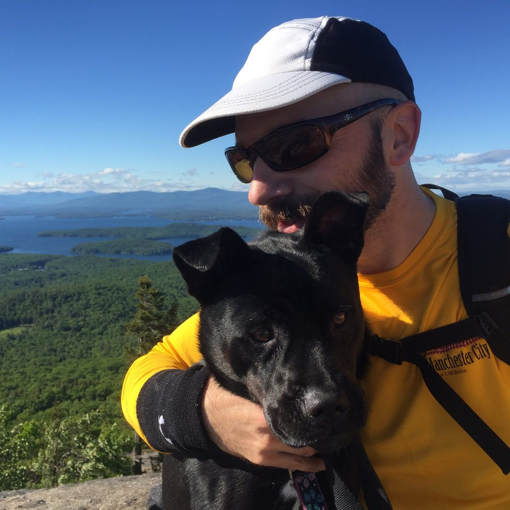 Enjoying the view from atop Mount Major with a dog walking client