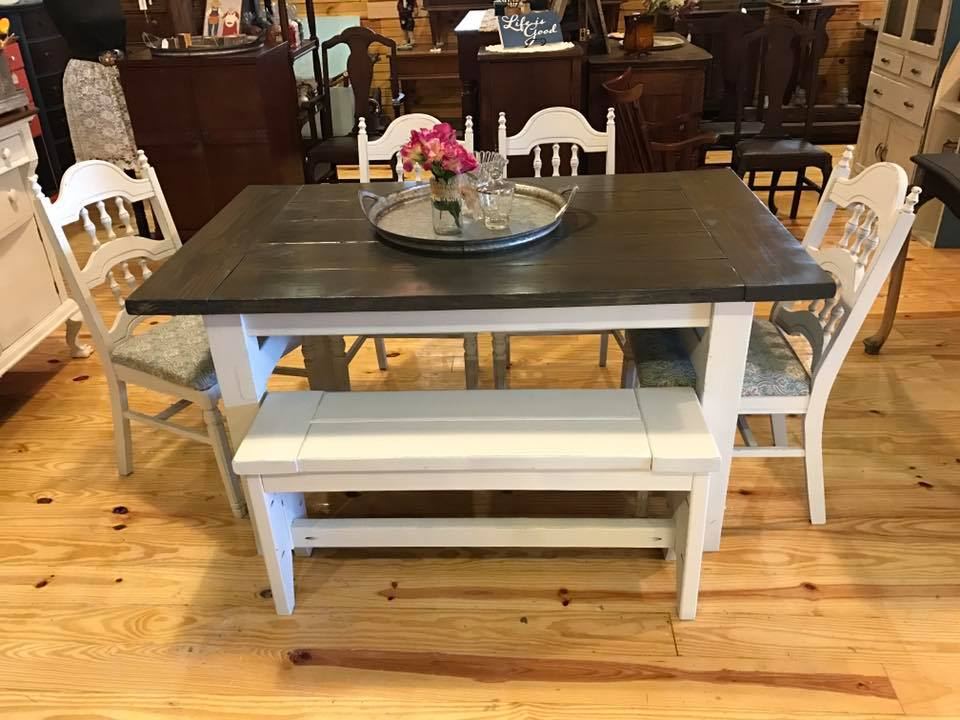 This table and bench were created for some of our clients.  The top was stained in a carbon grey while the bottom was painted in a white ash, and then distressed.  We also painted and recovered their chairs to match the finish.