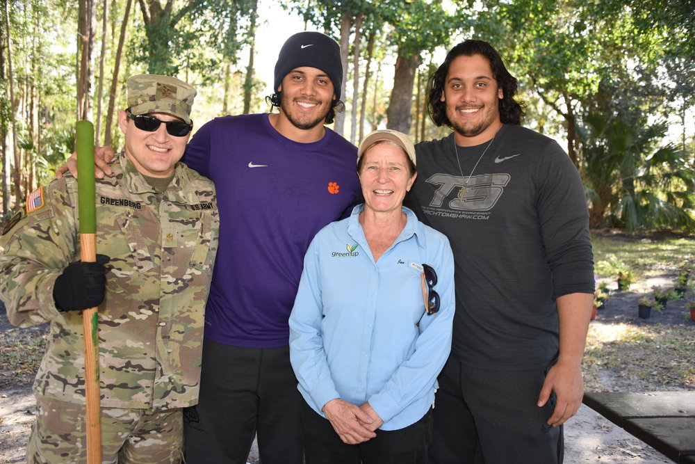 GreenUP Orlando Janice Rahill with NFL and 143rd soldier.JPG