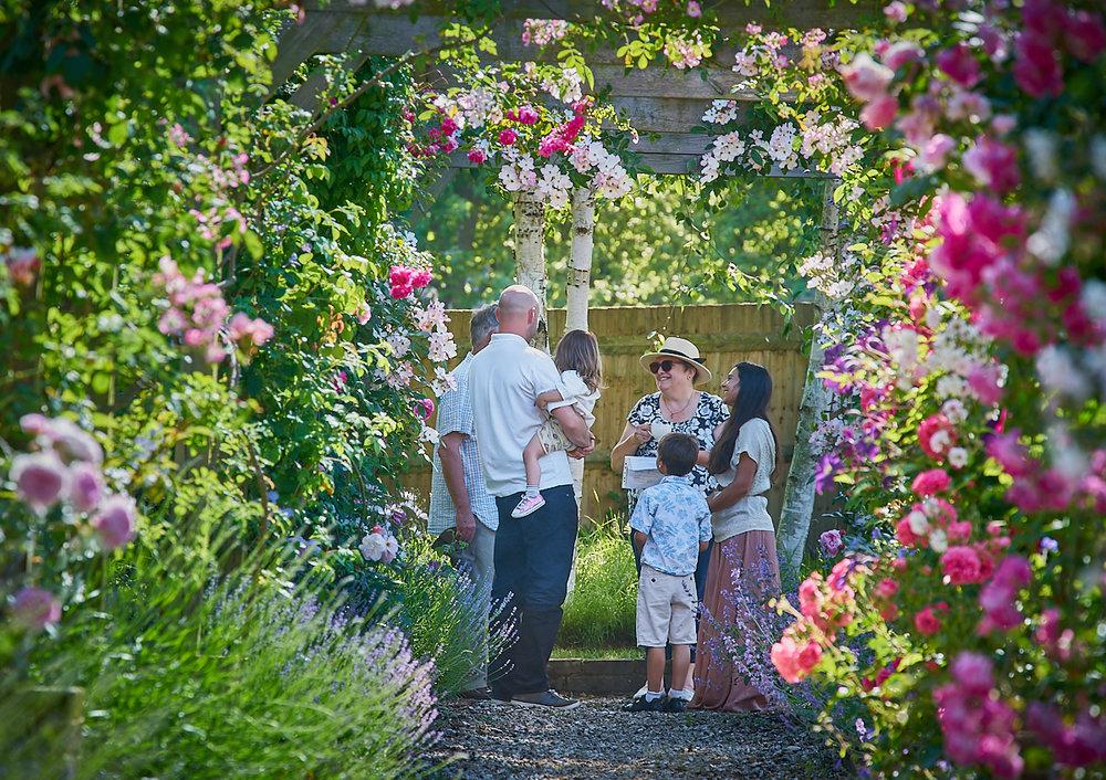 Family under a rose pergola