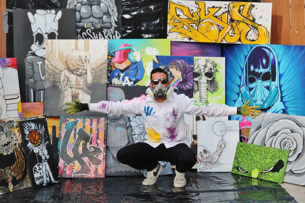 Matt Macias with artwork on display at Frogtown Brewery
