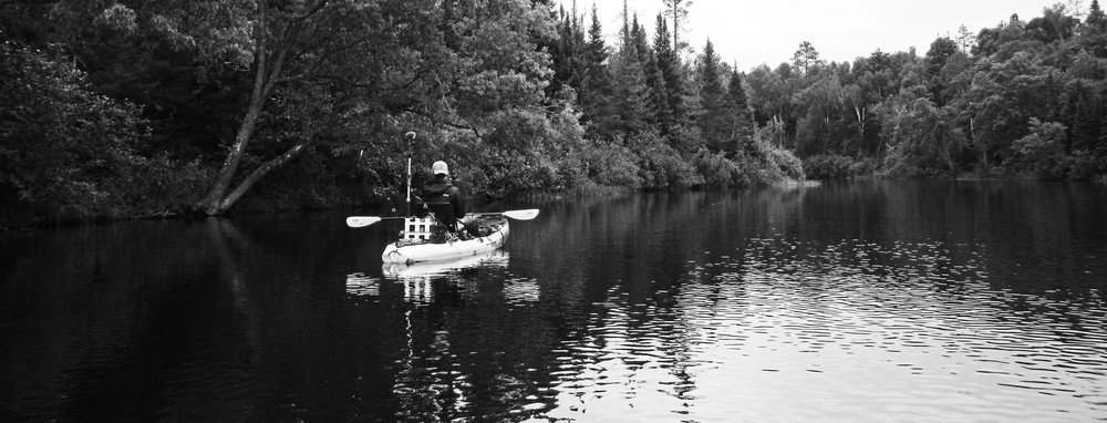Kayaking in search of muskie.    Photo credit to Jim of Into the Wild Fly Fishing Guide Service