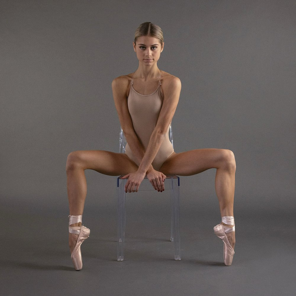 Classical Ballerina on an Acrylic Chair