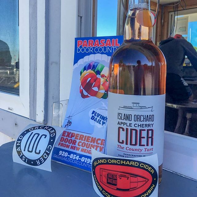 Our weekly giveaway!  Island Orchards, Apple Cherry Cider and some stickers. To be eligible, comment on this post a friend's name you want to share it with. We announce the winner on Wednesday. You must come to our kiosk to claim your prize if you win.  #parasaildc . . . . . #parasaildc #parasailing #parasail #parasailingtime #parasailingfun #parasailingadventures #vacationfun #vacation #fun #adventure #funthingstodo #watersports #watersportsfun #beach #parasailors #doorcounty #sisterbay #sisterbayDoorCo #sisterbaywisconsin #doorcountywisconsin #sisterbaymarina #parasailingparadise #parasailingday #familyfun #familyvacation #parasaildc #travelwisconsin #explorethedoor #discoverwisconsin @bruceleetags