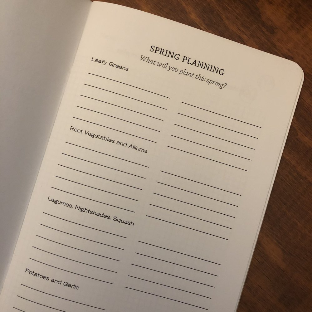 "An open notebook with ""Spring Planning"" printed at the top of the page."