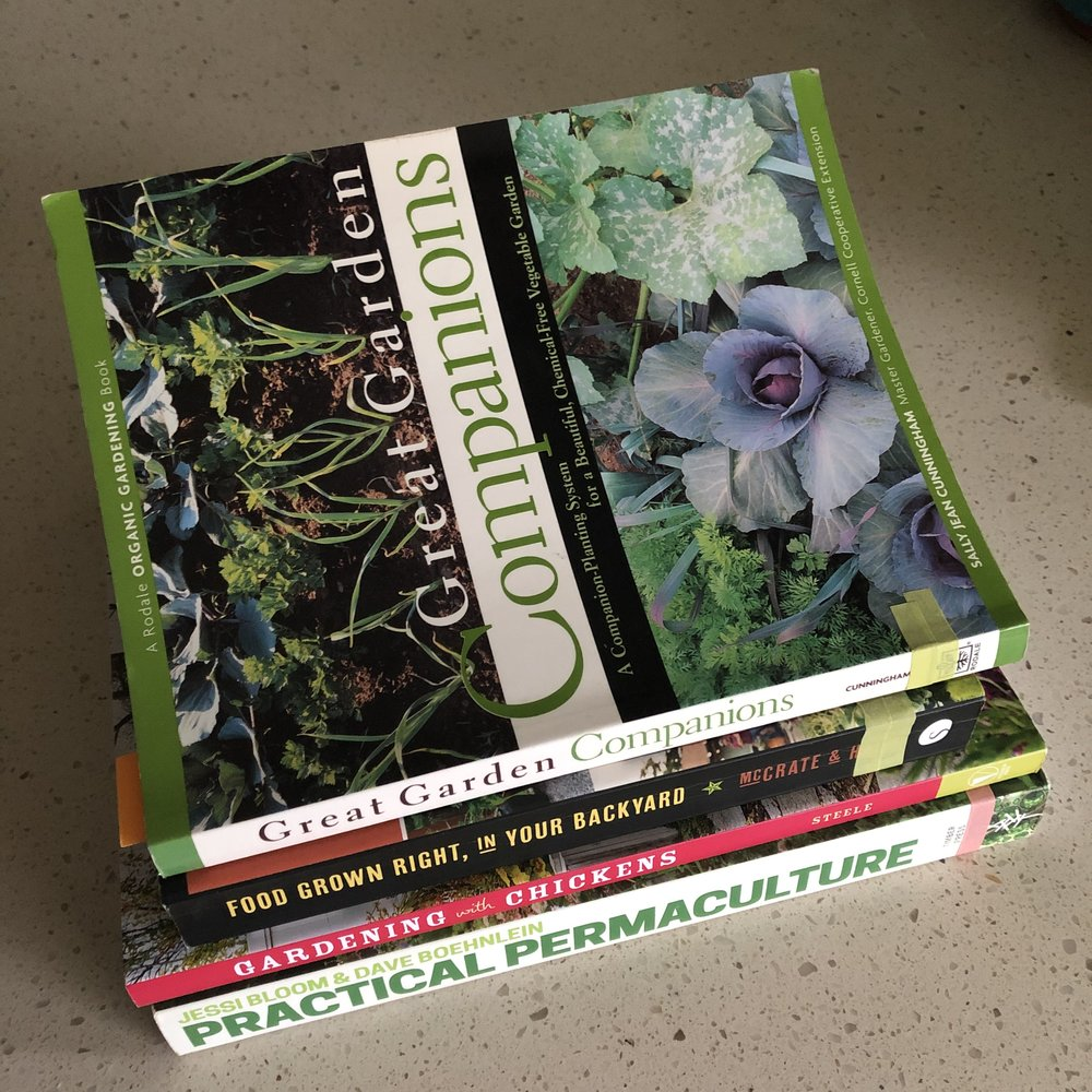 "A stack of garden books. The top book is called ""Great Garden Companions."""