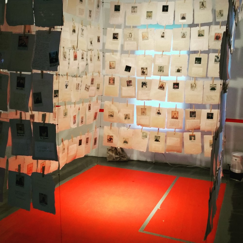 A recreation of an average sized solitary confinement cell, created by The People's Paper Co-op, exhibited in Houston in 2016.