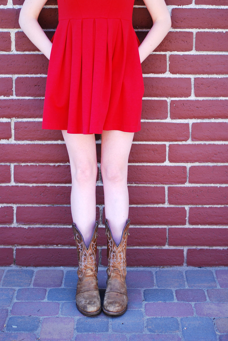 Red dress and Double H cowboy coots with lifestyle and travel blogger Bri Sul