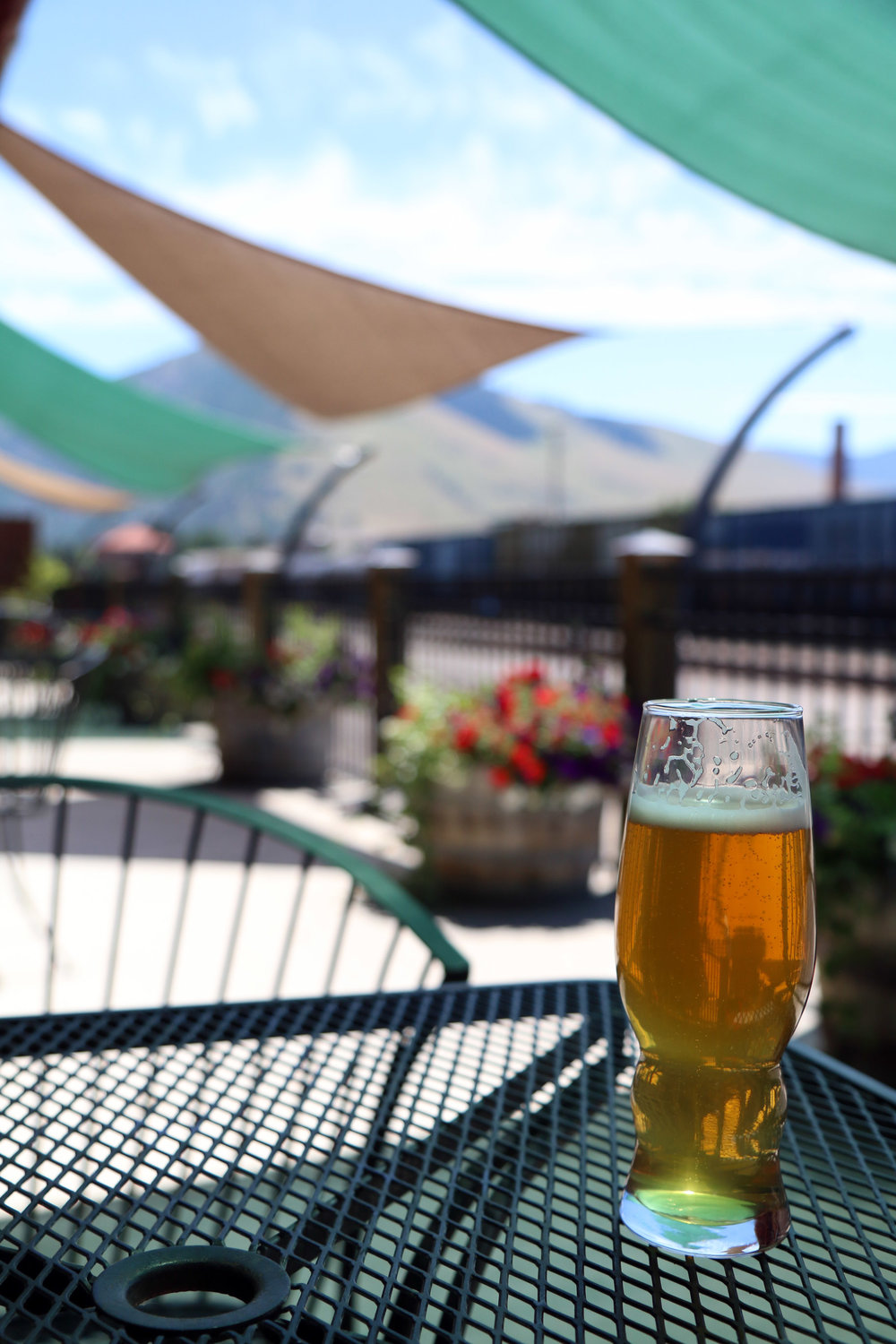 Northside Kettlehouse Brewery's patio in Missoula, Montana. The brewery has a great patio over the railroad tracks.
