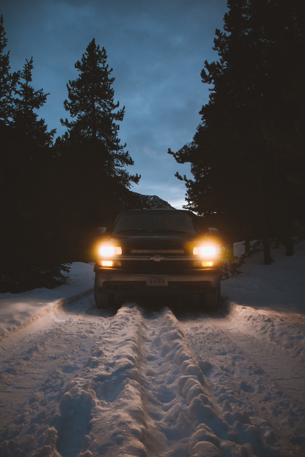 Truck lights in the snowy mountains of Montana by adventure photographer and lifestyle blogger Bri Sul