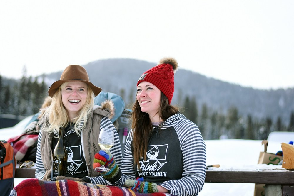 Bri Sul and her friend modeling for Live Montanably and Valo Cellar at Hyalite Reservoir near Bozeman, Montana