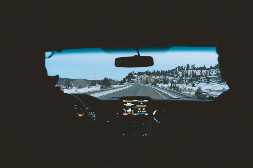 View from a pickup in snowy Montana during blue hour.