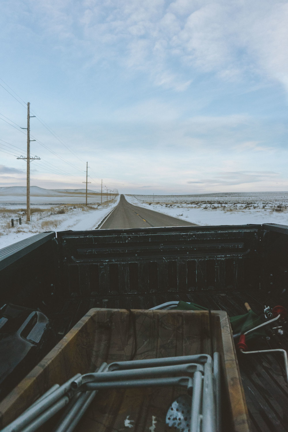 View out the back of a pickup truck. Going fishing in the morning.