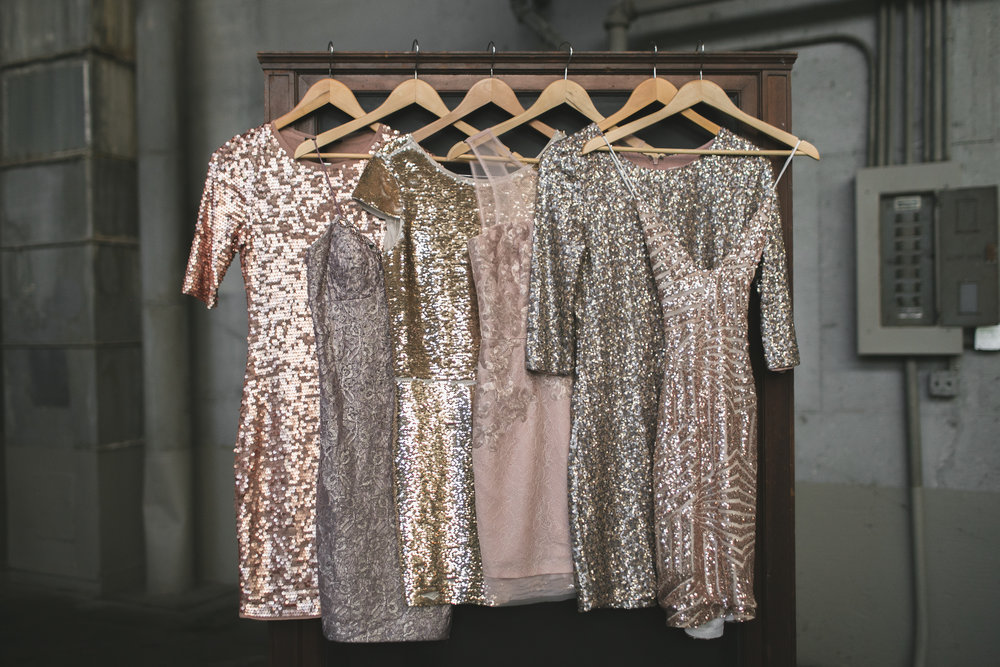 full length image of the shiny, sequinned bridesmaids dresses