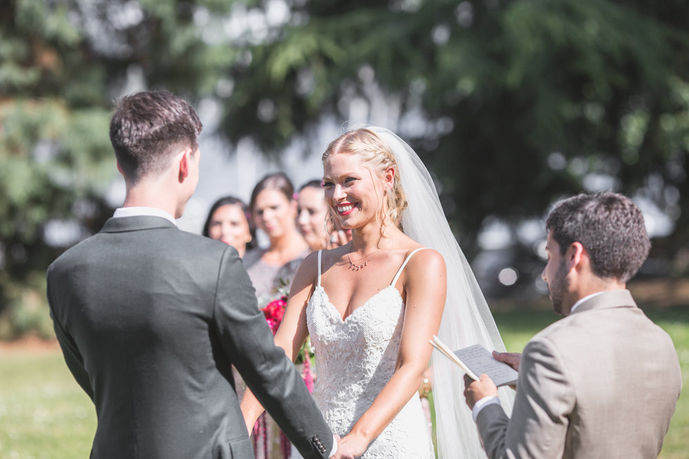 bride faces groom at the alter at leschi park in seattle
