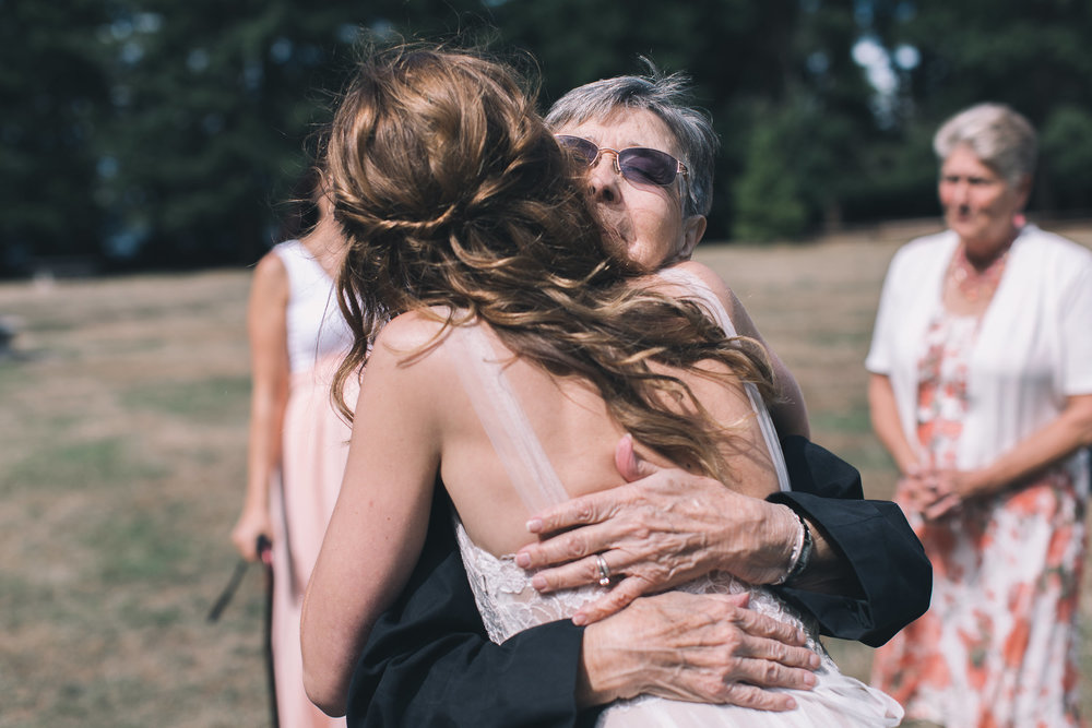 bride hugging grandma at kitsap memorial state park
