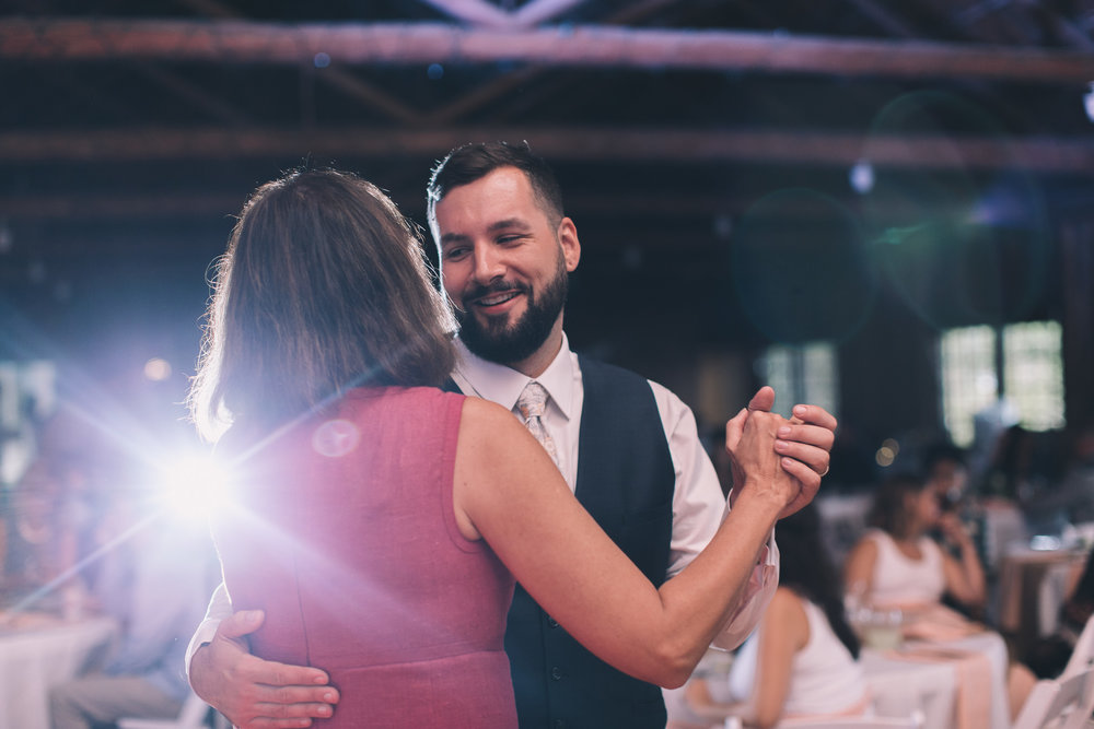 mother and groom dance at kitsap memorial state park log hall