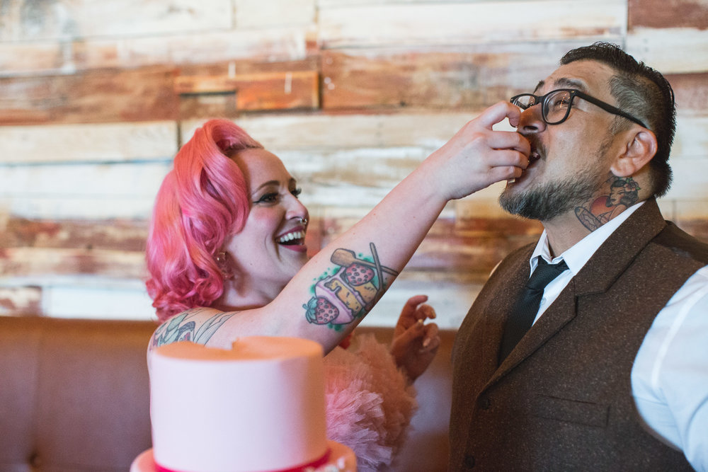 bride with tattoos and pink hair
