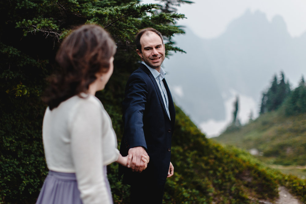 """come with me"" engagement photo in the cascade mountains"