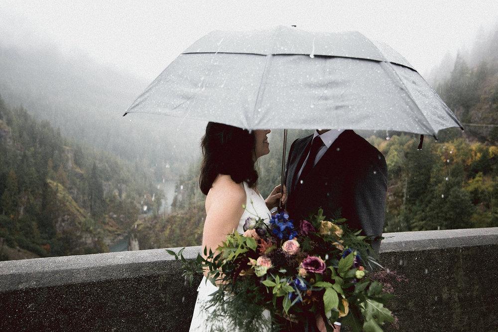 raining bride and groom portraits