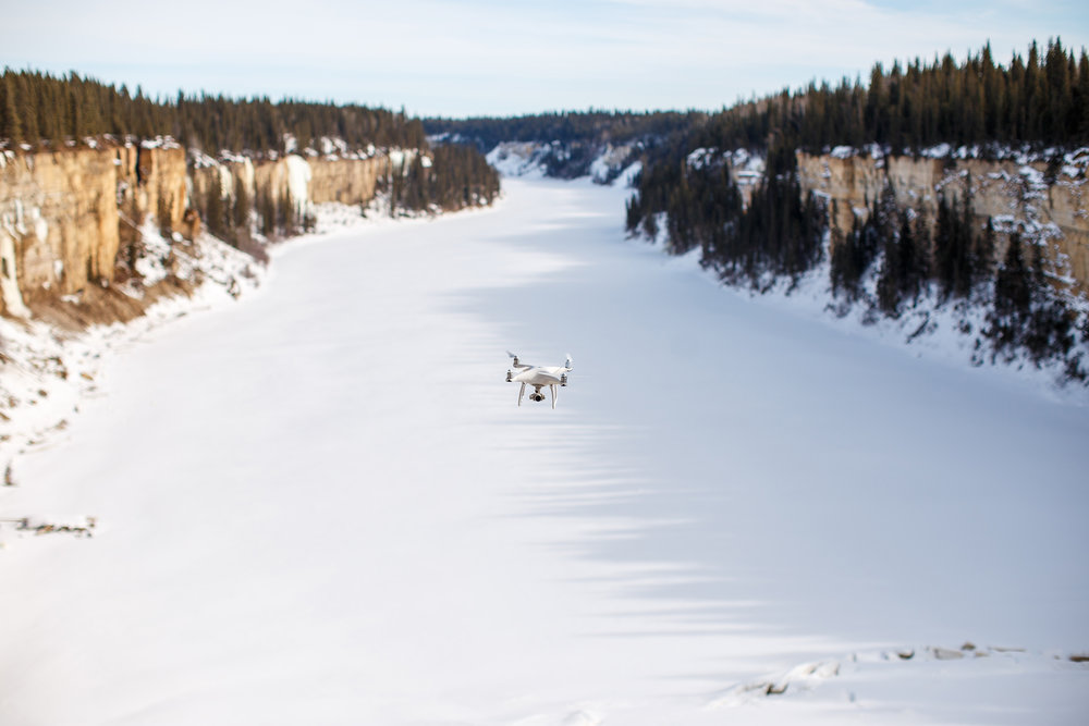 phantom drone over frozen river