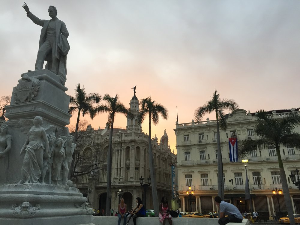The sunsets in Havana, aided by the city's noxious diesel fumes, are glorious. From left, a statue honoring José Martí, who fought for Cuba's independence during the late 19th century; the Gran Teatro de la Habana, home of the Cuban National Ballet; and the Hotel Inglaterra.