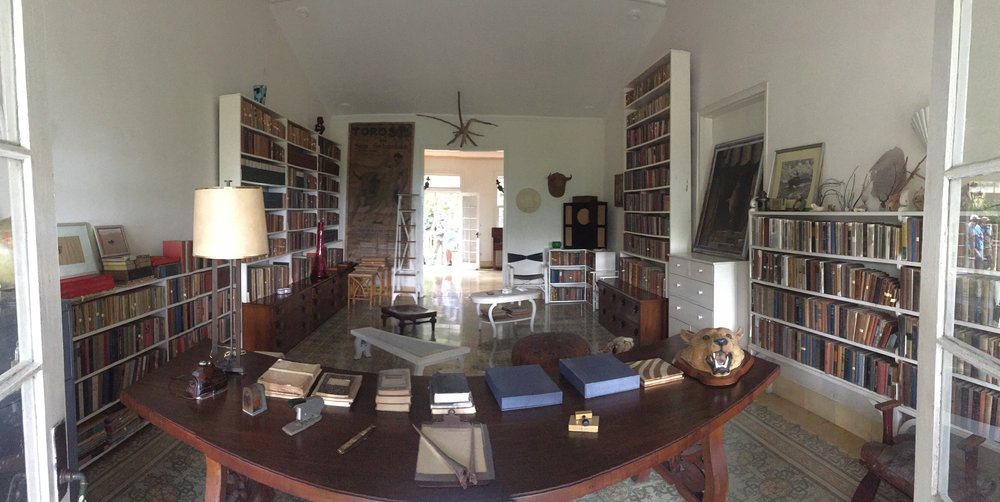 The interior of Finca Vigía, Hemingway's home outside Havana. Many books, many guns, many big game trophies.