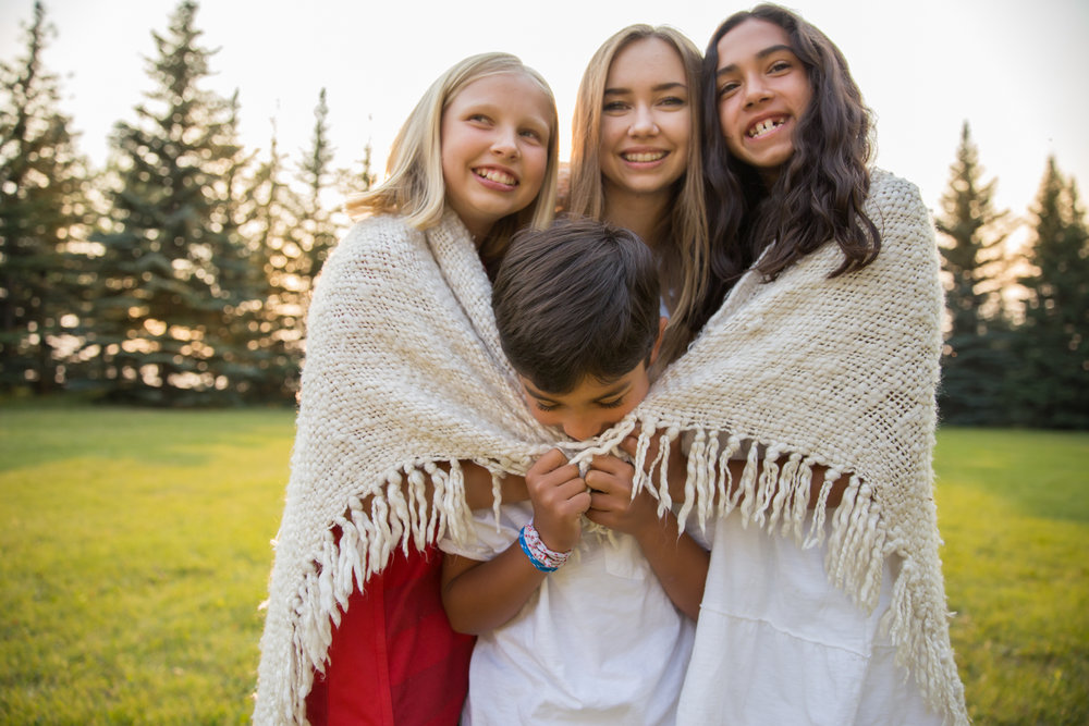 calgary children photography kids wrapped in a blanket and laughing