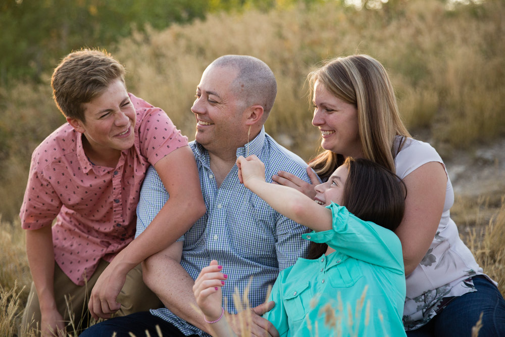 calgary family photography everyone laughing mom dad and older kids
