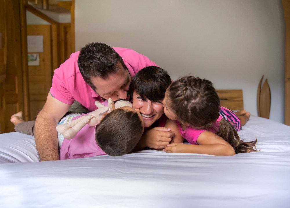 calgary family photography family kissing mom