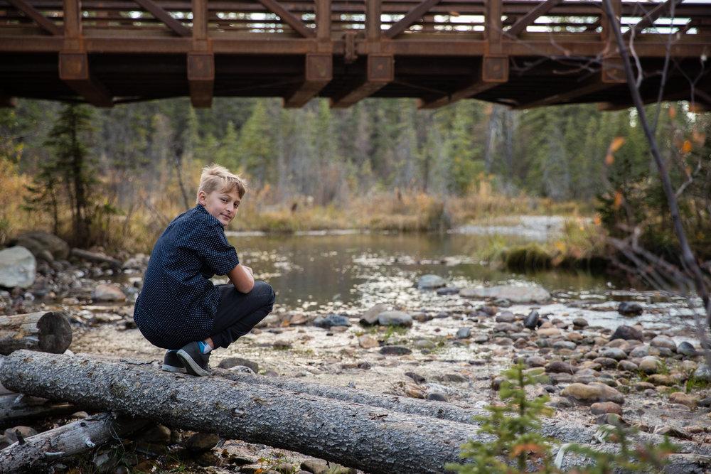 boy Griffith woods, bridge, calgary family photographer