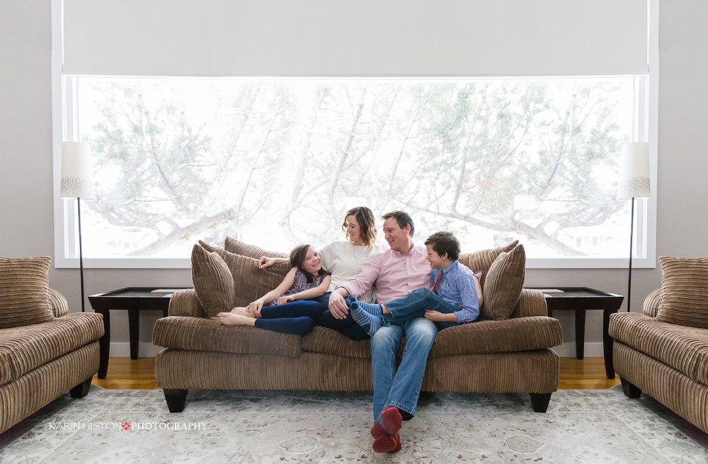 image of a family all together sitting on a couch |Calgary family photographer