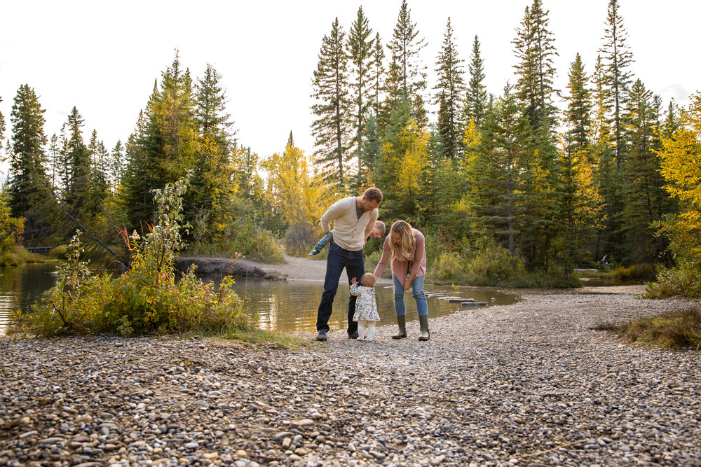 family at a lake going for a walk in the fall colours | Calgary family photographer