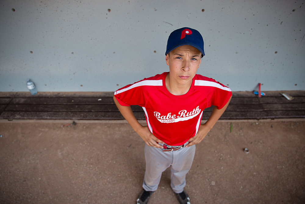 portrait of a baseball player in the dugout | Calgary child photographer
