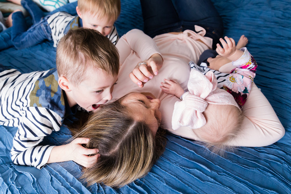 kids with mom on the bed