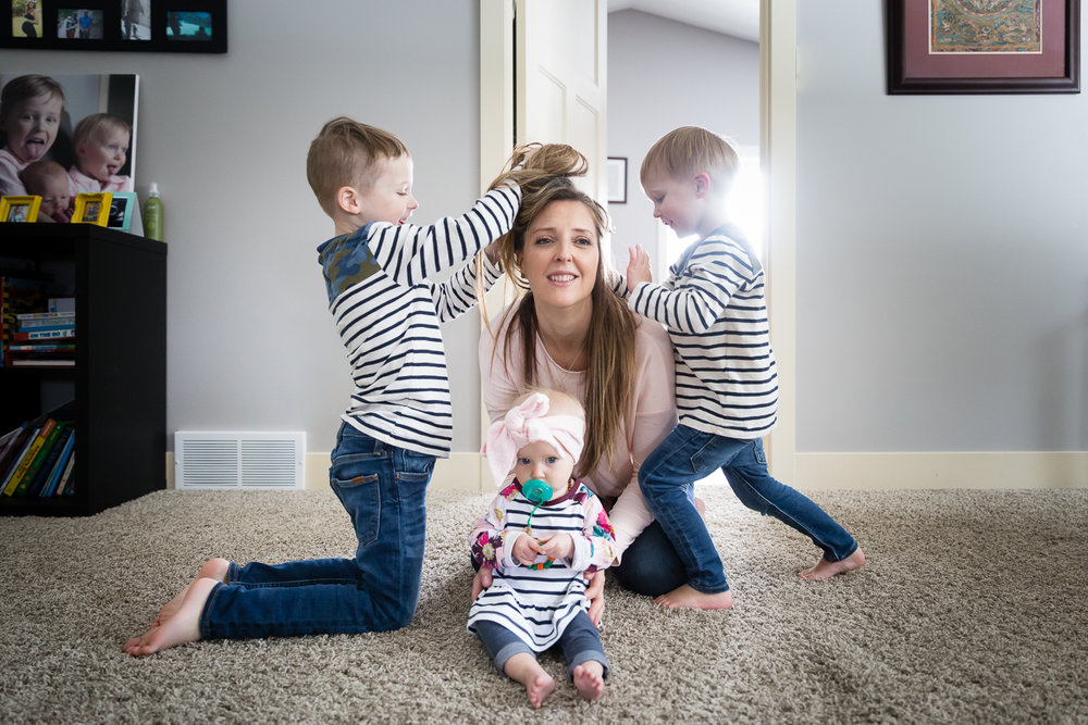 two boys with mom and baby in hallways