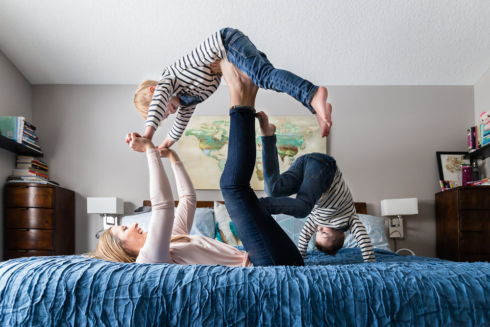 kids and mom playing airplane