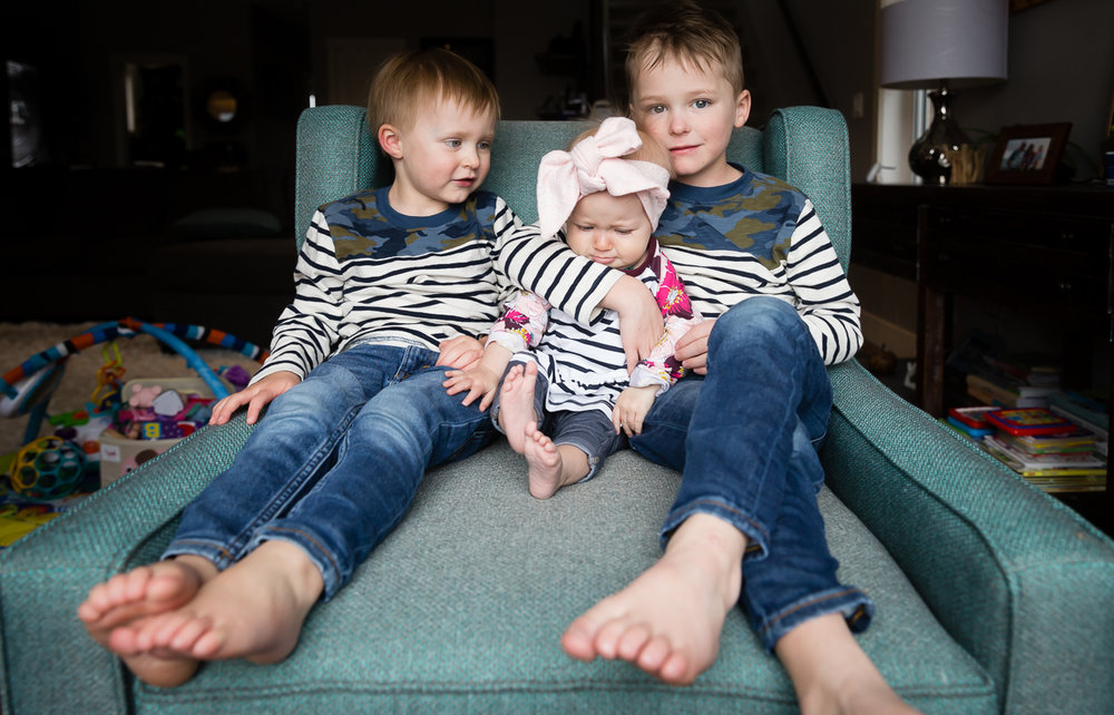 three kids in the green chair