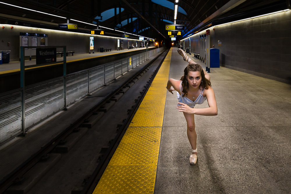 girl near the train tracks in a tunnel