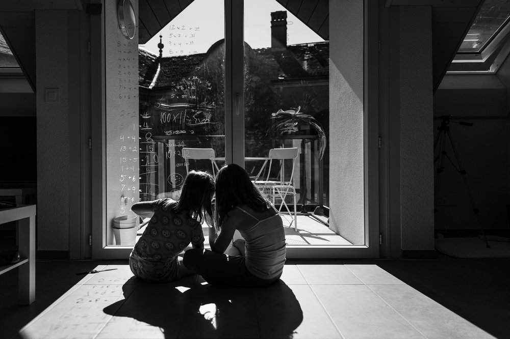 two kids at the window about numbers