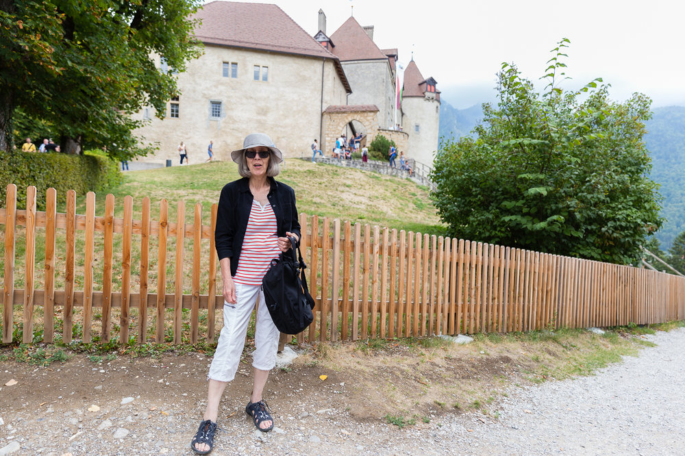 Oma in Gruyere in front of the gorgeous castle. Distracted by ice cream after a day at the chocolate factory we have to leave the castle exploration to the next visit!