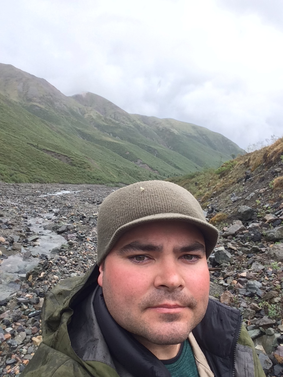 The only pic taken from my 1st backpacking trip in the Yukon. Bock's Creek behind me. Didn't plan on posting it which is why I'm not smiling. Taken after a tough hike climbing over 900m in elevation with a backpack that was way too heavy. My legs were taxed after this.  What I learned: mountains here are big, I need to hit the gym.