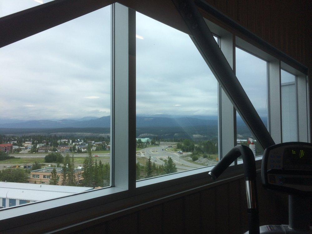 View from the Canada Game Centre. This place is awesome. Great workout facility, indoor track, pools, sauna, steam room and other sport facilities. For $44/month, it's worth it! Great view of the mountains while you're working out.