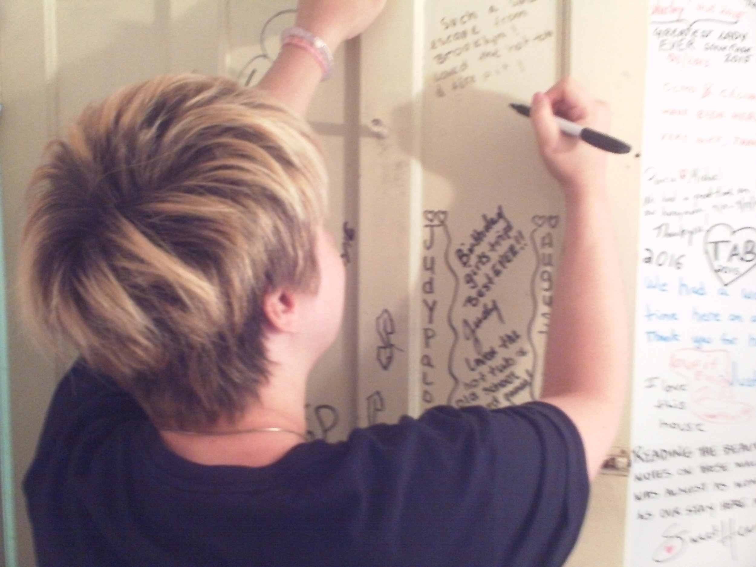 Instead of the normal guest book, the owners have the visitors sign the walls and doors of the bathroom. Super cute!