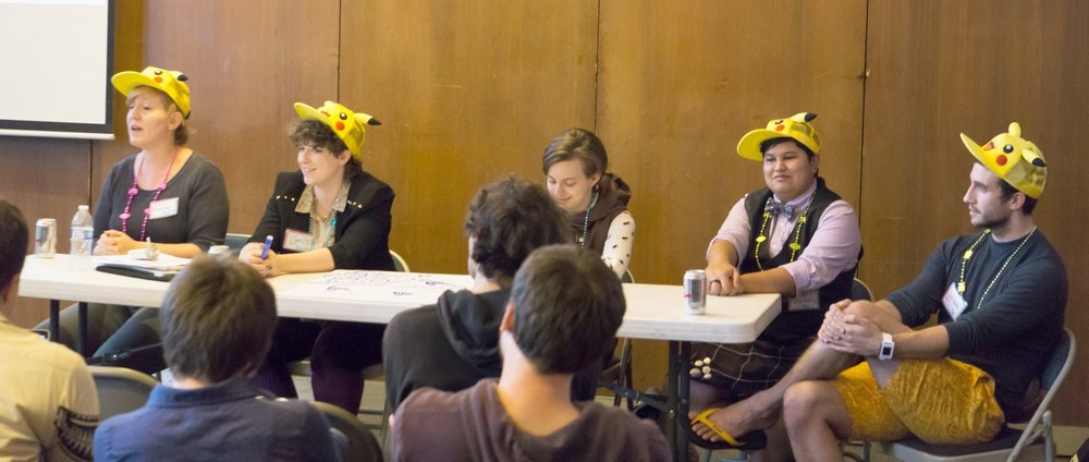 "The idea for our ""In Practice"" section began at QGCon 2015 at UC Berkeley. The organizers all wore Pikachu hats to the closing session; aren't we cute? Left to Right: Bonnie (""Bo"") Ruberg, Teddy Pozo (me), Zoyander Street, Dietrich Squinkifer, and Christopher Goetz. Not pictured is co-organizer Chelsea Howe."