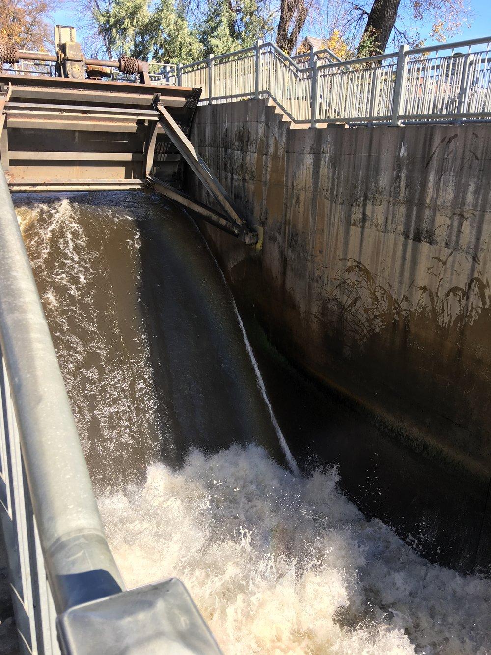 Water gushing through the open gate